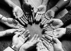 hands in, working together, person-centred support