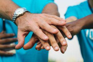hands in, help, board members, volunteer with us, do good work, community living guelph wellington