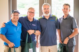 cliff arcand, ian clarke, and team winning lowest net at Norm Jary Golf Tournament