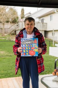 we've got this, photo series, one year later, covid-19, community living guelph wellington, elle chic photography, guelph ontario, disability, frontline heroes, laurie, connect four, games night