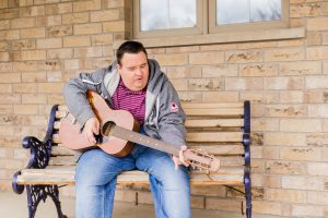 we've got this, photo series, one year later, covid-19, community living guelph wellington, elle chic photography, guelph ontario, disability, frontline heroes, mike, guitar